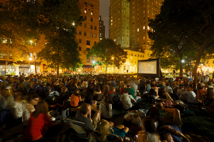 """A large crowd assembled on the east lawn of Rittenhouse Sqaure to watch uwishunu.com's """"Moonlit Movie,"""" Midnight in Paris."""